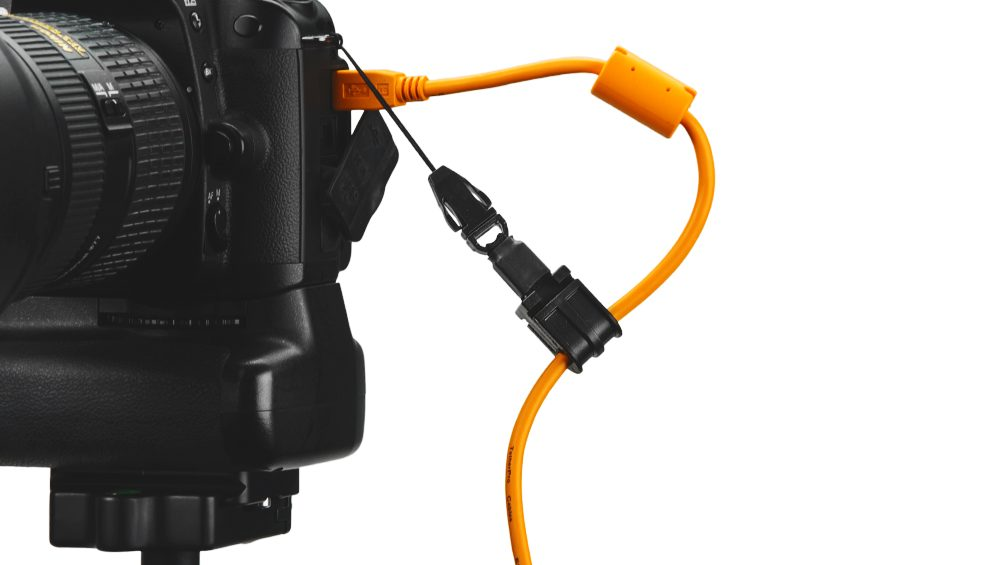 JerkStopper Camera Support connected to a camera and usb cable