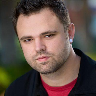 A portrait shot of Zach Sutton